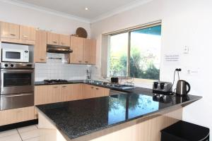 A kitchen or kitchenette at Diamond House in The Entrance Beach