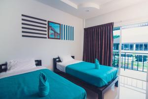 A bed or beds in a room at Sky Resort Kanchanaburi