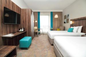 A television and/or entertainment center at Courtyard by Marriott Sarajevo