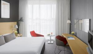 A bed or beds in a room at Radisson Blu Hotel, Glasgow