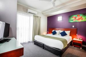 A bed or beds in a room at Novotel Darwin Airport