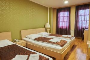 A bed or beds in a room at ETN Hotel