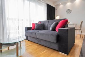 Ein Sitzbereich in der Unterkunft The Queen Luxury Apartments - Villa Fiorita