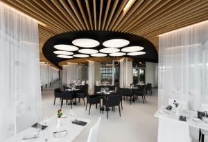 A restaurant or other place to eat at Aquapalace Hotel Prague