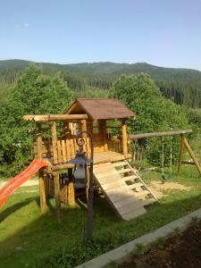 Children's play area at Pension Perla Bucovinei