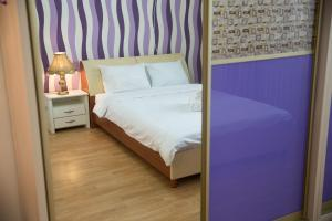 A bed or beds in a room at AHome 77 at Al-Farabi ave