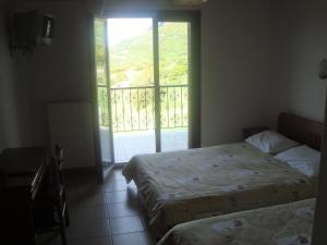 Ein Bett oder Betten in einem Zimmer der Unterkunft Guesthouse Arsenis