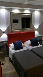 A bed or beds in a room at Hotel Center 1&2