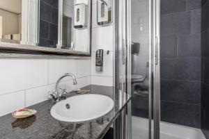Een badkamer bij Villahotel Vlissingen