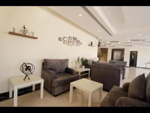 منطقة جلوس في  بارادايس النرجس للأجنحة الفندقية