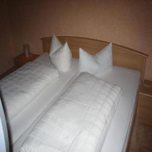 Ein Bett oder Betten in einem Zimmer der Unterkunft Pension Klaashof