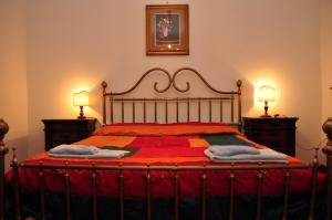 A bed or beds in a room at RELAIS Le Querciole