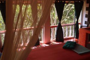 A bed or beds in a room at Namaste Yoga Farm