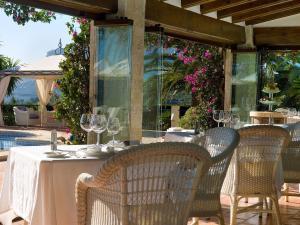 Un restaurante o sitio para comer en Boutique Hotel La Madrugada