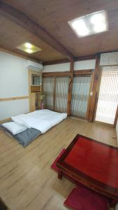 A bed or beds in a room at Charm Hanok Guest House
