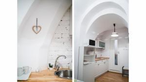 O bucătărie sau chicinetă la Nicolae Balcescu Apartment