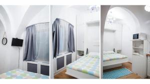 Un pat sau paturi într-o cameră la Nicolae Balcescu Apartment