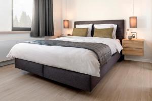 A bed or beds in a room at International Büllingen