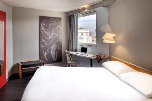 Un ou plusieurs lits dans un hébergement de l'établissement ibis Vichy