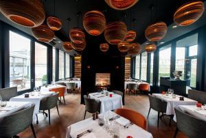 Een restaurant of ander eetgelegenheid bij Hotel Montanus