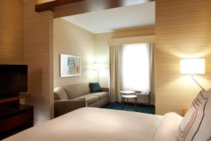 A bed or beds in a room at Fairfield Inn & Suites by Marriott Lethbridge