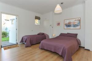 Кровать или кровати в номере Hotel Pension de Harmonie