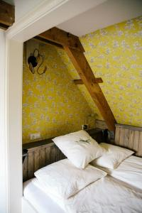 A bed or beds in a room at Louisehoeve Holiday Home