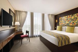 A bed or beds in a room at Ramada Resort Dar es Salaam