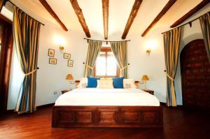 Cama o camas de una habitación en Palacete Belmonte