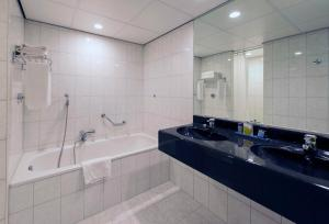 A bathroom at Grand Hotel Amstelveen