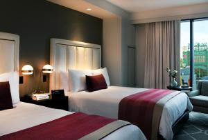 A bed or beds in a room at Boston Hotel Commonwealth