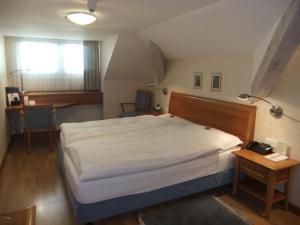 Ein Bett oder Betten in einem Zimmer der Unterkunft Hotel Hecht Appenzell