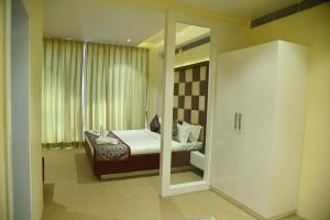 Кровать или кровати в номере Viz Park Hotel