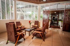 A seating area at Hotel Cabaña Quinta
