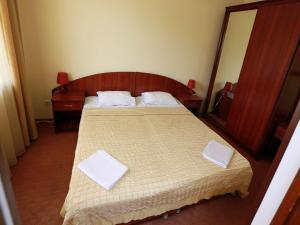 Кровать или кровати в номере Гостиница «Ак-гёль»