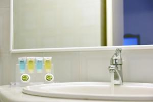 A bathroom at Sidra Hotel