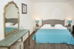 Ein Bett oder Betten in einem Zimmer der Unterkunft Hotel De Walvisvaarder
