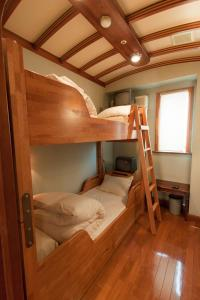 A bunk bed or bunk beds in a room at Capsule Inn Osaka (Male Only)