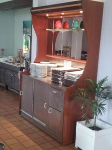 A kitchen or kitchenette at Central Hotel