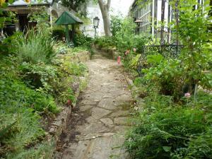 A garden outside Old Colony Inn