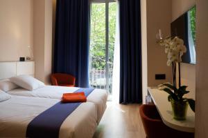 Ein Bett oder Betten in einem Zimmer der Unterkunft Chi