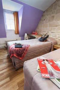 Cama o camas de una habitación en Le Montclair Montmartre by River