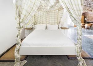 Cama o camas de una habitación en Cuevas del Pino Turismo Rural y Emocional SL