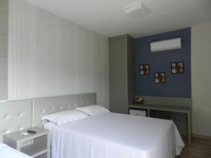 A bed or beds in a room at Splendore Hotel
