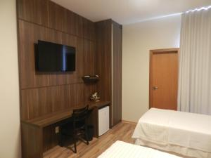 A television and/or entertainment center at Splendore Hotel