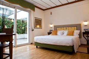 Letto o letti in una camera di Palace Hotel