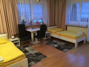 Ein Sitzbereich in der Unterkunft Haus Tina Zimmer