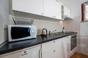 A kitchen or kitchenette at Apartments Severina