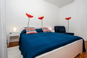 A bed or beds in a room at Apartments Severina