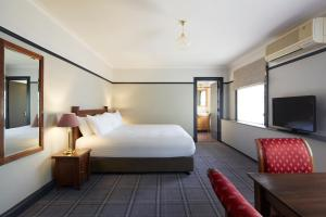 A bed or beds in a room at Brassey Hotel - Managed by Doma Hotels